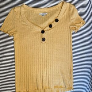 Yellow American eagle shirt with buttons.